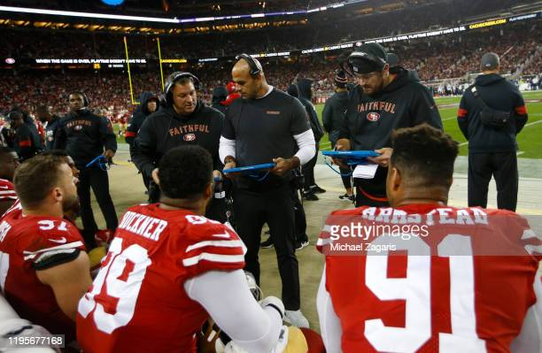 Defensive Coordinator Robert Saleh of the San Francisco 49ers talks with the defensive line on the sideline during the game against the Los Angeles...