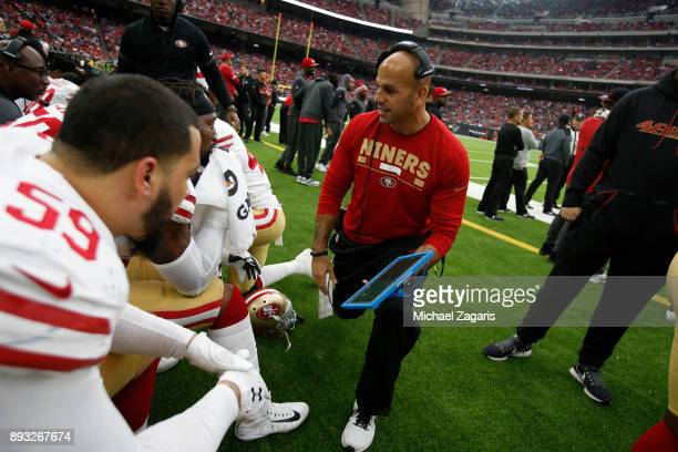 Defensive Coordinator Robert Saleh of the San Francisco 49ers talks with the linebackes on the sideline during the game against the Houston Texans at...