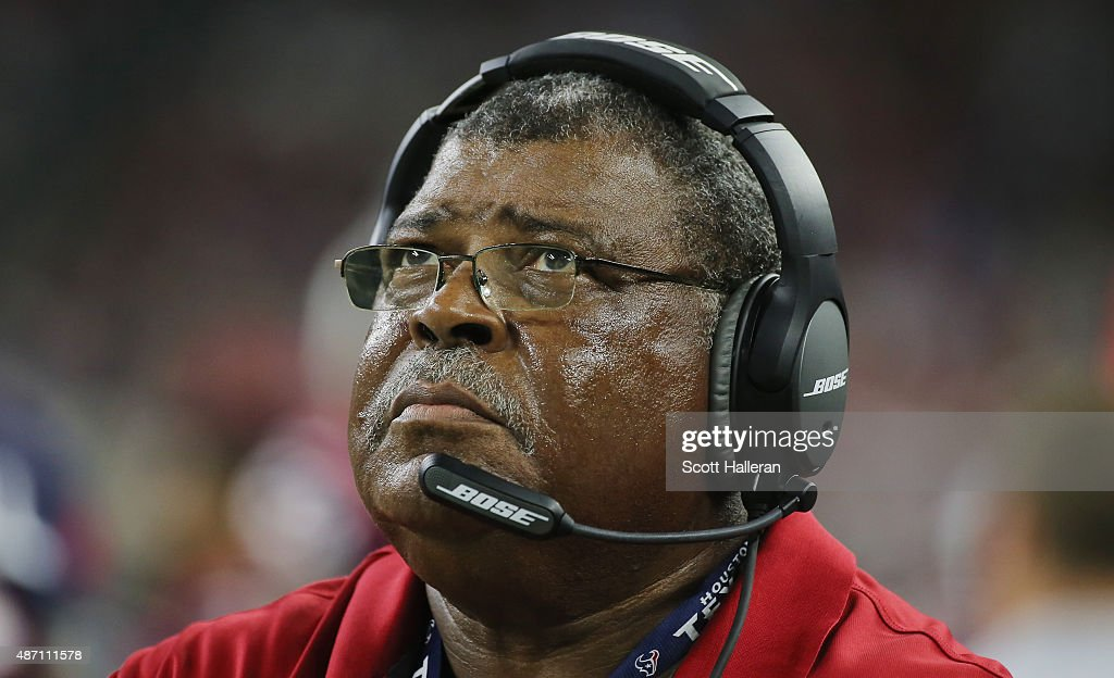 Defensive coordinator Romeo Crenne of the Houston Texans waits in the bench area during their game against the Denver Broncos at NRG Stadium on August 22, 2015 in Houston, Texas.