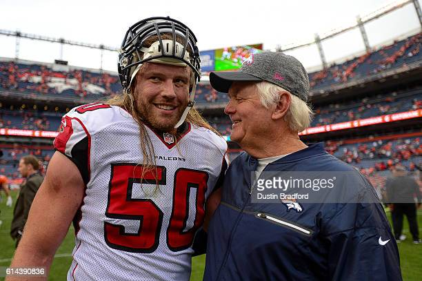 Defensive coordinator Wade Phillips of the Denver Broncos has a word with linebacker AJ Hawk of the Atlanta Falcons after a game at Sports Authority...