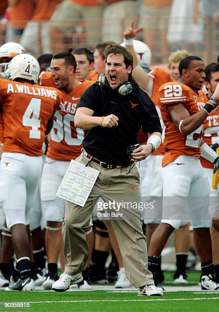 Defensive coordinator Will Muschamp of the Texas Longhorns gets pumped up after a turnover by the Louisiana Monroe Warhawks in the first quarter on...