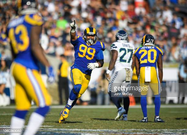 Defensive end Aaron Donald of the Los Angeles Rams celebrates a sack in the second quarter against the Seattle Seahawks at Los Angeles Memorial...