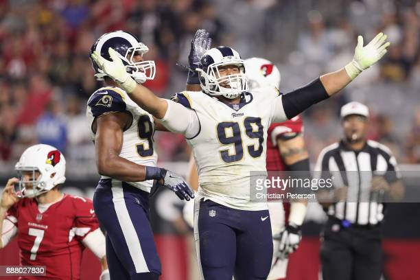 Defensive end Aaron Donald of the Los Angeles Rams reacts after a tackle on quarterback Blaine Gabbert of the Arizona Cardinals during the second...