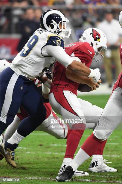 Defensive end Aaron Donald of the Los Angeles Rams tackles quarterback Blaine Gabbert of the Arizona Cardinals during the first half of the NFL game...