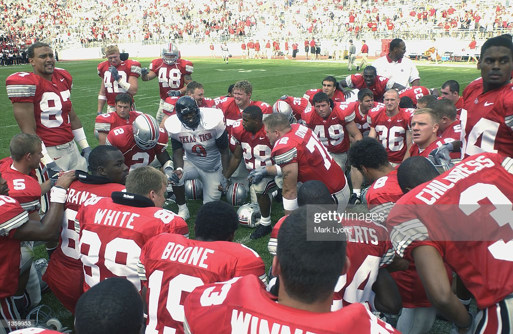 Defensive end Aaron Hunt #9 of the Texas Tech Red Raiders prays with the Ohio State Buckeyes after the NCAA Pigskin Classic on August 24, 2002 at Ohio Stadium in Columbus, Ohio. Ohio State defeated Texas Tech 45-21.