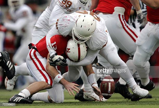 Defensive end Aaron Lewis of the Texas Longhorns forces a fumble by quarterback Zac Taylor of the Nebraska Cornhuskers on October 21 2006 at Memorial...