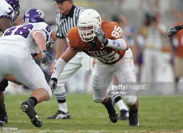 Defensive End Aaron Lewis of the Texas Longhorns makes a move at the line of scrimmage during their game against the TCU Horned Frogs on September 8...