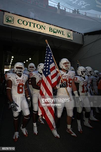 Defensive end Aaron Lewis the Texas Longhorns carries an enters the field before the Red River Rivalry game against the Oklahoma Sooners at the...