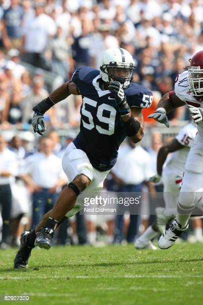 Defensive end Aaron Maybin of the Penn State Nittany Lions rushes the quarterback against the University of Temple Owls at Beaver Stadium on...