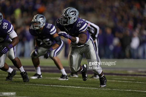 Defensive end Adam Davis of the Kansas State Wildcats rushes against the Oklahoma State Cowboys at Bill Snyder Family Football Stadium on November 3...