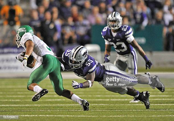 Defensive end Adam Davis of the Kansas State Wildcats tackles wide receiver Brelan Chancellor of the North Texas Mean Green during the third quarter...