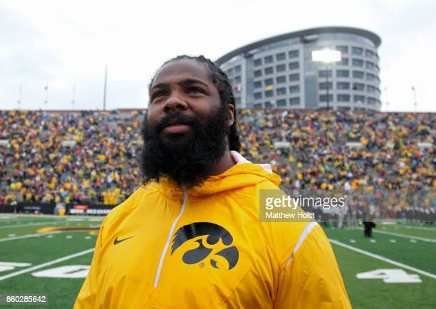 Defensive end Adrian Clayborn of the Atlanta Falcons serves as the honorary captain for the Iowa Hawkeyes before their matchup against the Illinois...