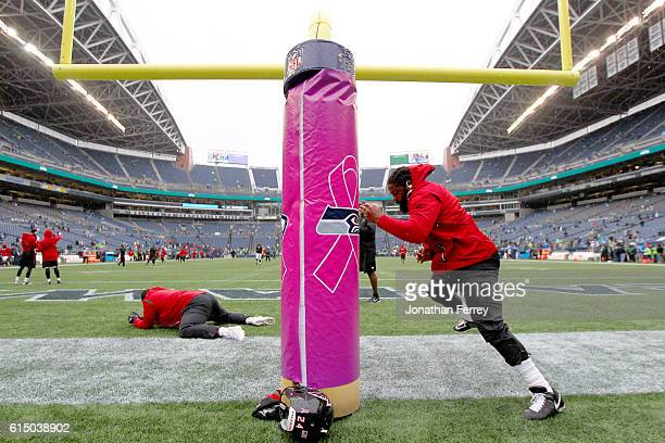 Defensive end Adrian Clayborn of the Atlanta Falcons warms up before facing the Seattle Seahawks at CenturyLink Field on October 16, 2016 in Seattle,...