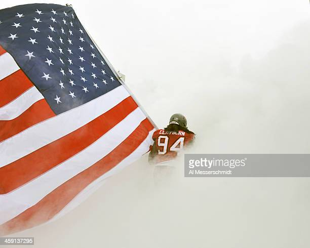 Defensive end Adrian Clayborn of the Tampa Bay Buccaneers takes the field carrying the American Flag for play against the San Francisco 49ers...