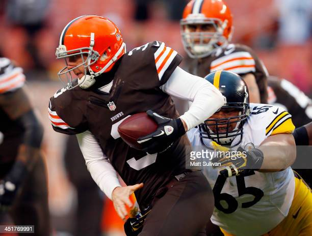 Defensive end Al Woods of the Pittsburgh Steelers sacks quarterback Brandon Weeden of the Cleveland Browns at FirstEnergy Stadium on November 24 2013...