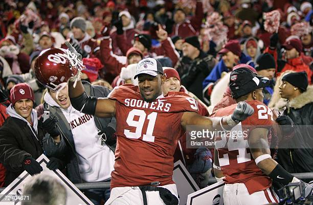 Defensive end Alonzo Dotson of the Oklahoma Sooners celebrates amongst fans after winning the 2006 Dr Pepper Big 12 Championship against the Nebraska...