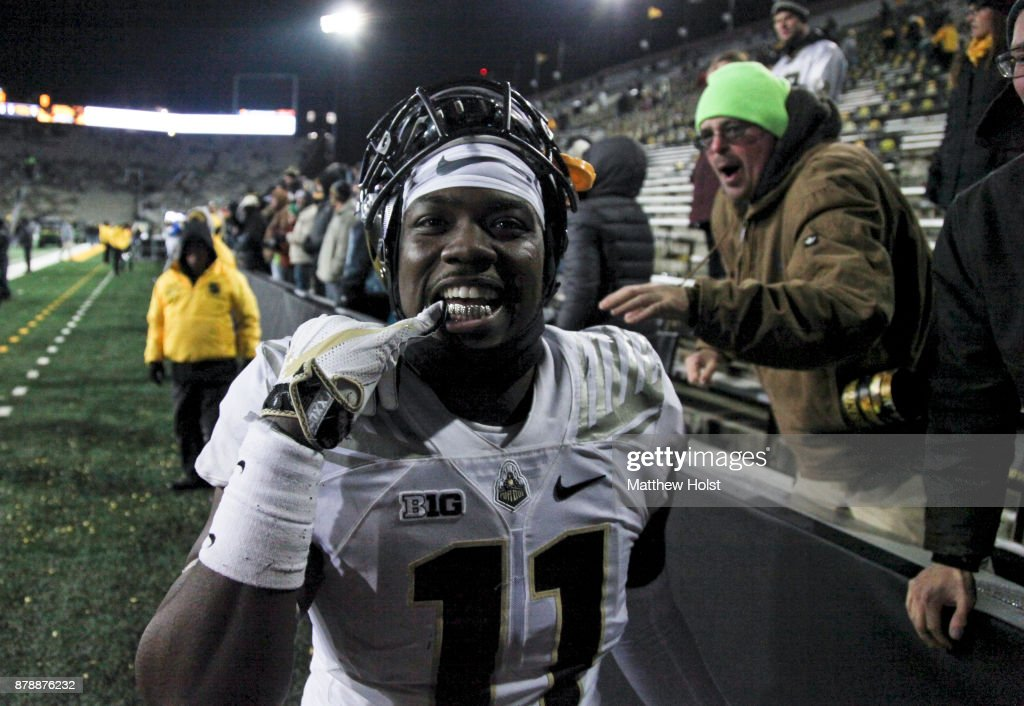 Defensive end Antoine Miles #11 of the Purdue Boilermakers flashes his gold teeth as he celebrates after defeating the Iowa Hawkeyes on November 18, 2017 at Kinnick Stadium in Iowa City, Iowa.