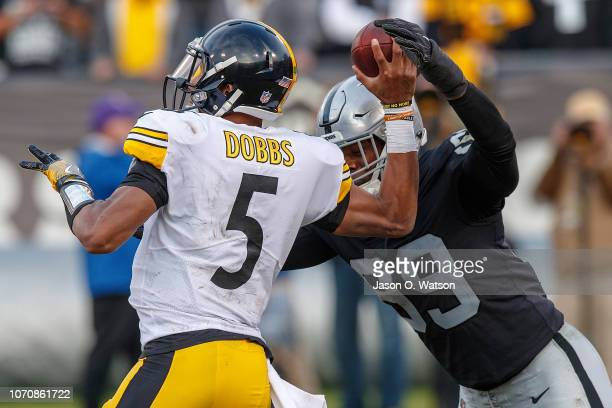 Defensive end Arden Key of the Oakland Raiders forces an incomplete pass from quarterback Joshua Dobbs of the Pittsburgh Steelers during the third...