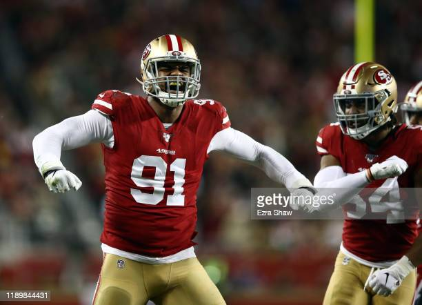 Defensive end Arik Armstead of the San Francisco 49ers reacts after making a stop during the first quarter of the game against the Green Bay Packers...