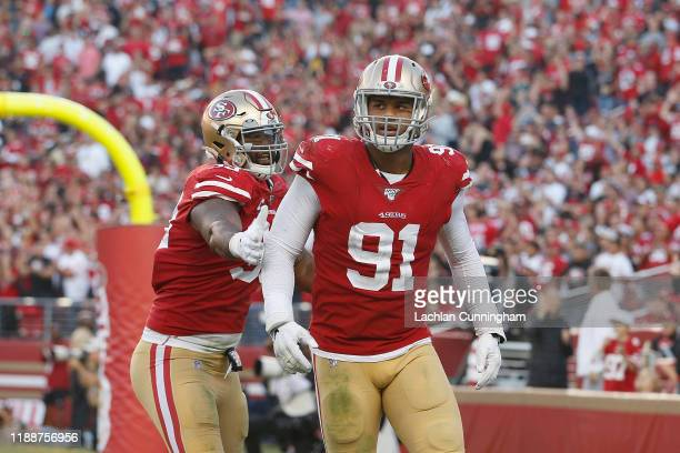 Defensive end Arik Armstead of the San Francisco 49ers reacts with DeForest Buckner after making a tackle on quarterback Kyler Murray of the Arizona...