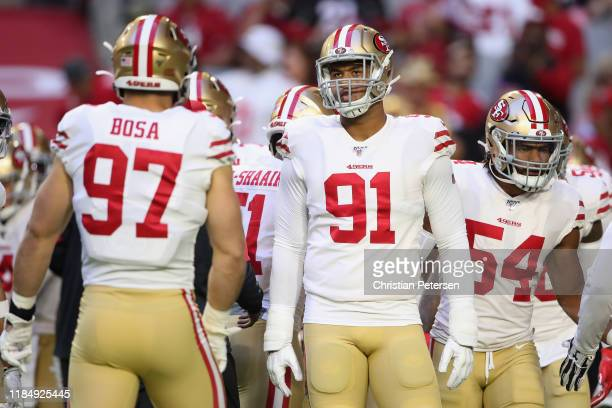 Defensive end Arik Armstead of the San Francisco 49ers warms up before NFL game against the Arizona Cardinals at State Farm Stadium on October 31...
