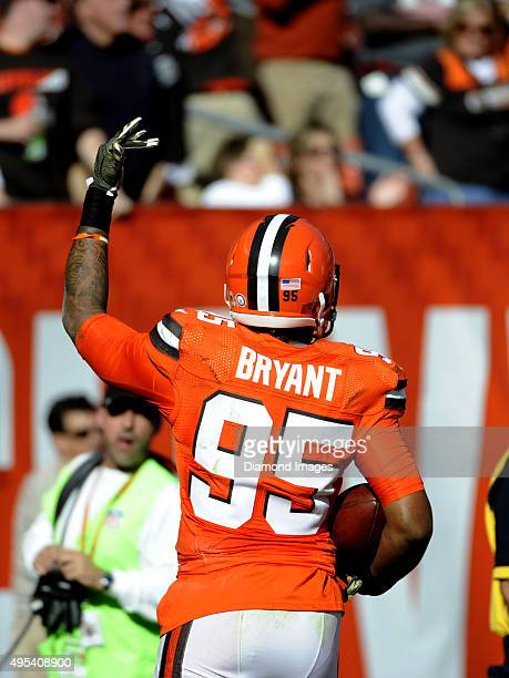Defensive end Armonty Bryant of the Cleveland Browns celebrates a fumble recovery down the field during a game against the Arizona Cardinals on...