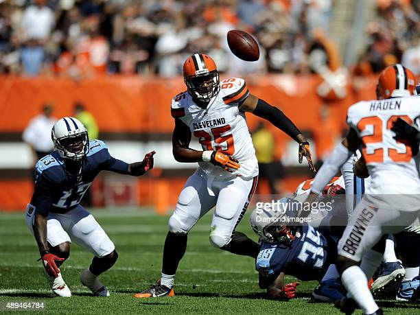 Defensive end Armonty Bryant of the Cleveland Browns pursues a fumble by running back Terrence West of the Tennessee Titans during a game on...