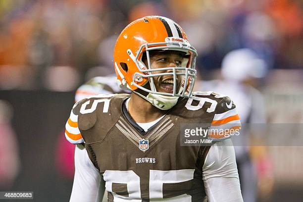 Defensive end Armonty Bryant of the Cleveland Browns smiles on the field between plays against the Buffalo Bills during the second half at...