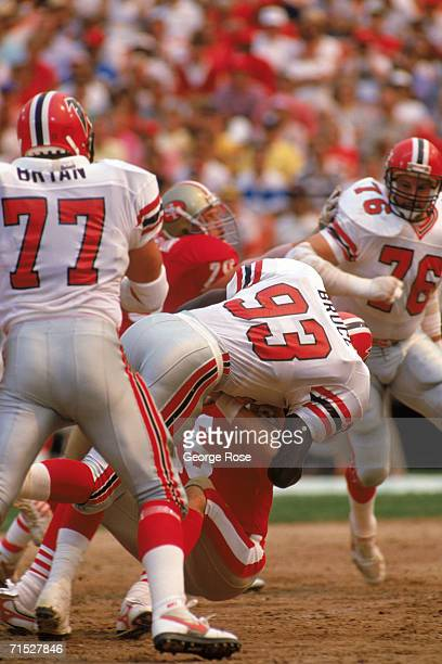 Defensive end Aundray Bruce of the Atlanta Falcons sacks San Francisco 49ers quarterback Joe Montana during a game at Candlestick Park on September...