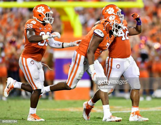 Defensive end Austin Bryant defensive end Clelin Ferrell and defensive lineman Christian Wilkins of the Clemson Tigers celebrate following a sack...