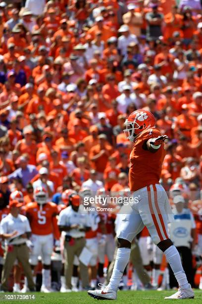 Defensive end Austin Bryant of the Clemson Tigers gestures to the crowd following a defensive play during the Tigers' football game against the...