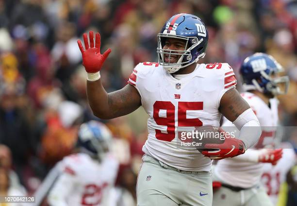 Defensive end B.J. Hill of the New York Giants reacts after a third down in the first quarter against the Washington Redskins at FedExField on...