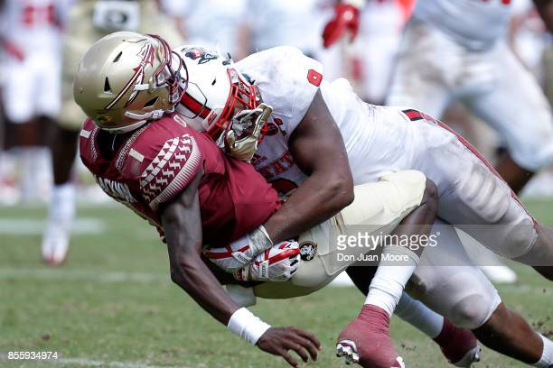 Defensive End Bradley Chubb of the North Carolina State Wolfpack make a tackle on Quarterback James Blackman of the Florida State Seminoles during...