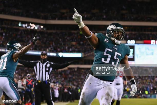 Defensive end Brandon Graham and cornerback Jalen Mills of the Philadelphia Eagles celebrate against the Atlanta Falcons during the fourth quarter in...