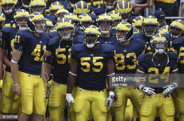 Defensive end Brandon Graham of the Michigan Wolverines leads the team onto the field prior to the start of the game against the Indiana Hoosiers at...