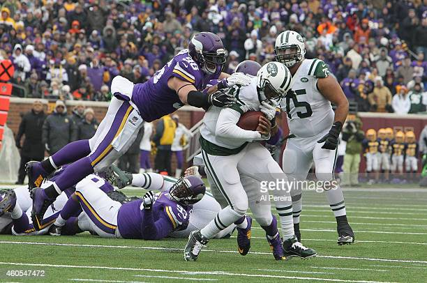 Defensive End Brian Robison of the Minnesota Vikings grabs Quarterback Geno Smith of the New York Jets at TCFBank Stadium on December 7, 2014 in...