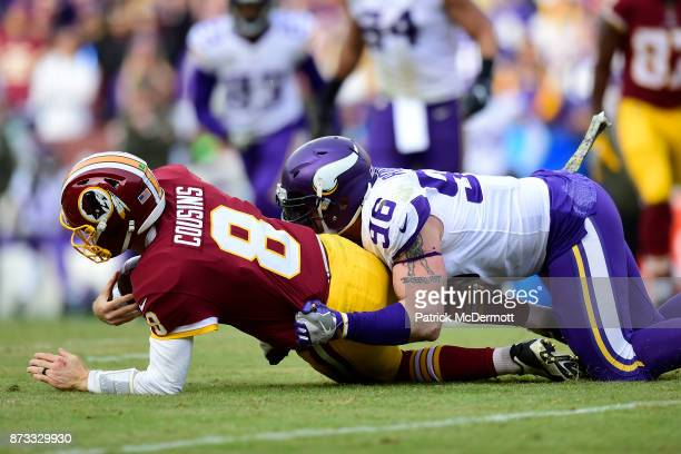 Defensive end Brian Robison of the Minnesota Vikings sacks quarterback Kirk Cousins of the Washington Redskins during the third quarter at FedExField...