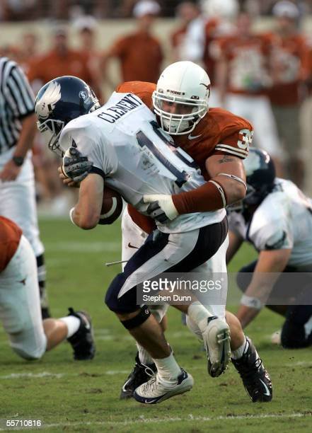 Defensive end Brian Robison of the Texas Longhorns tackles quarterback Chase Clement of the Rice Owls on September 17, 2005 at Darrell K Royal-Texas...