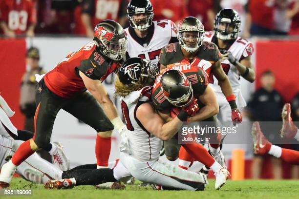 Defensive end Brooks Reed of the Atlanta Falcons tackles wide receiver Adam Humphries of the Tampa Bay Buccaneers late in the fourth quarter on...