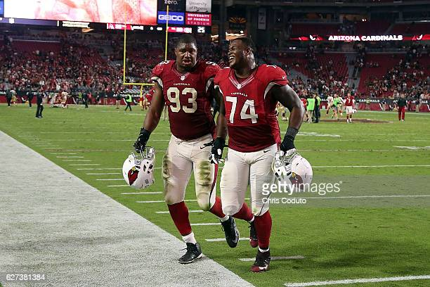 Defensive end Calais Campbell and offensive tackle DJ Humphries of the Arizona Cardinals walk off the field after during the NFL football game...