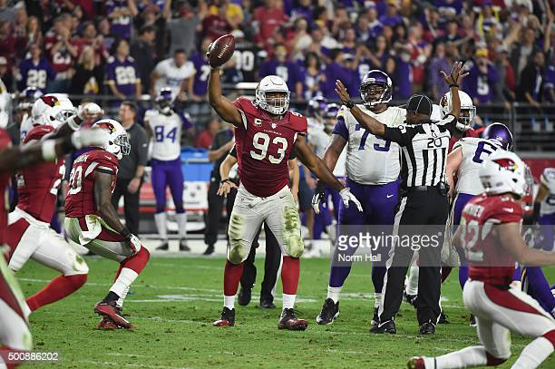 Defensive end Calais Campbell of the Arizona Cardinals celebrates after recovering the fumbled football in the final moments of the NFL game against...