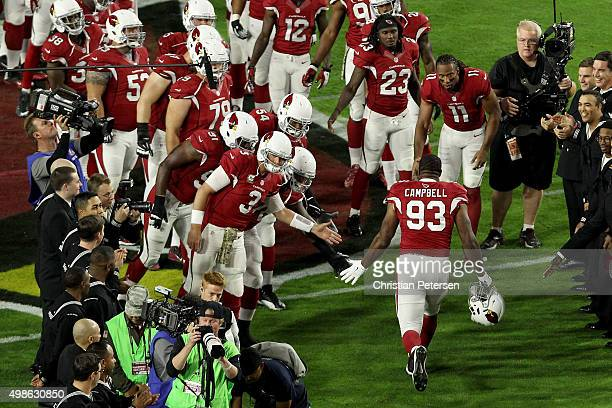 Defensive end Calais Campbell of the Arizona Cardinals highfives quarterback Carson Palmer as he is introduced before the NFL game against the...