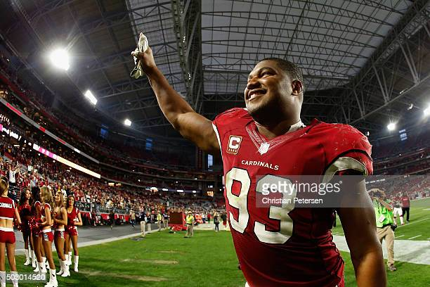 Defensive end Calais Campbell of the Arizona Cardinals walks off the field following the NFL game against the Green Bay Packers at the University of...