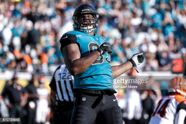 Defensive End Calais Campbell of the Jacksonville Jaguars celebrates a tackle during the game against the Cincinnati Bengals at EverBank Field on...