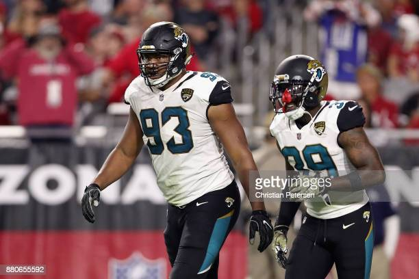 Defensive end Calais Campbell of the Jacksonville Jaguars reacts after scoring a touchdown against the Arizona Cardinals during the second half of...