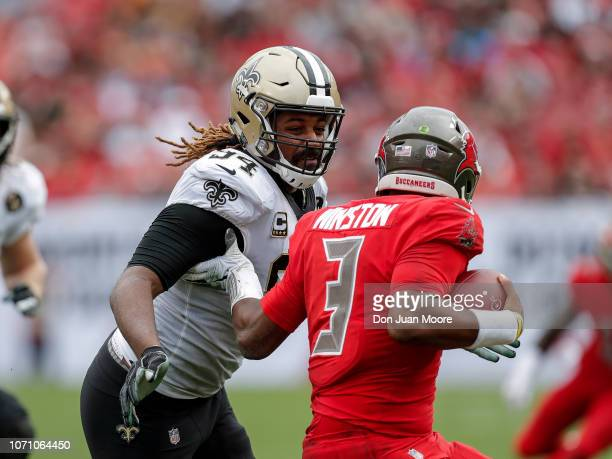 Defensive End Cameron Jordan of the New Orleans Saints makes a tackle on Quarterback Jameis Winson of the Tampa Bay Buccaneers during the game at...