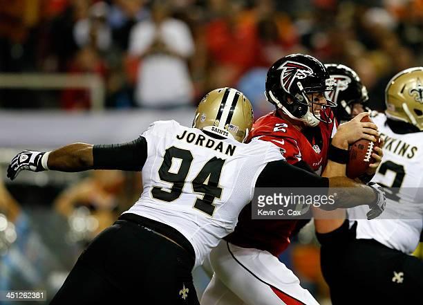 Defensive end Cameron Jordan of the New Orleans Saints sacks quarterback Matt Ryan of the Atlanta Falcons during a game at the Georgia Dome on...