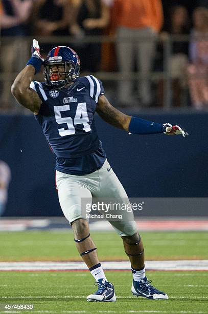 Defensive end Carlos Thompson of the Mississippi Rebels celebrates after a big play during their game against the Tennessee Volunteers on October 18...