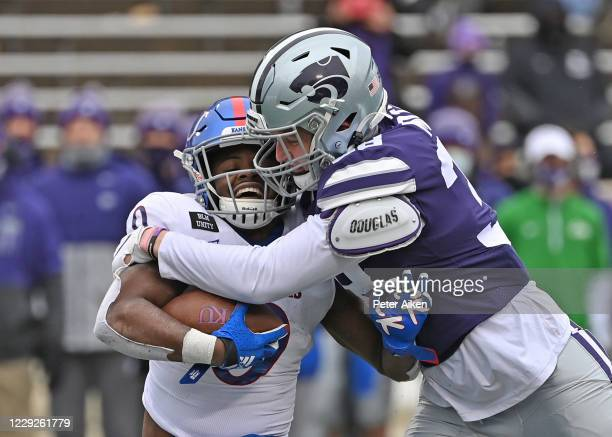 Defensive end Cartez Crook-Jones of the Kansas State Wildcats tackles running back Velton Gardner of the Kansas Jayhawks for a loss, during the...