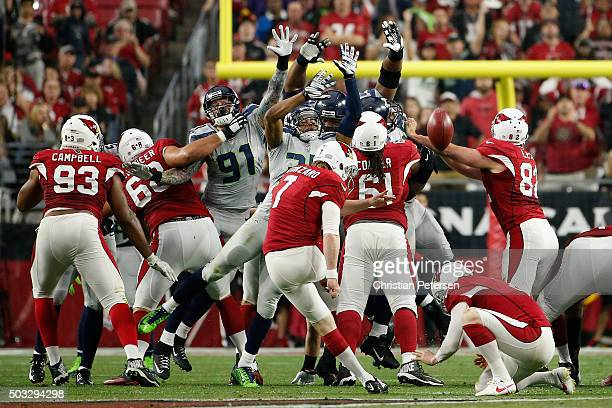 Defensive end Cassius Marsh and DeShawn Shead of the Seattle Seahawks attempt to block an unsuccessful field goal kicked by Chandler Catanzaro of the...